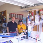 "Steve Vincent and Gordon Hall in Sal's model plane garage workshop.  Steve Vincent and Sal learned to fly together.  He is now a tenured captain at UPS.  Gordon was Sal's adopted flying dad, instructor and mentor.  He passed recently and was a decorated aviator.  He was in World War II, Vietnam and Korea.  He flew Hueys in Vietnam and Korea and started flying in the 40's.  He was an extremely demanding instructor, often creating fear and discipline in the hearts and minds of his students. ""If you survived his training, you had nothing to worry about on your check rides."""